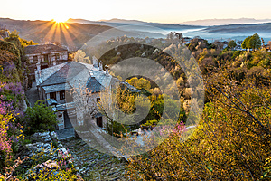 First sun rays on the picturesque village of Vitsa in Zagori area, Northern Greece