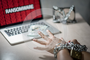 Ransomware cyber attack on laptop computer
