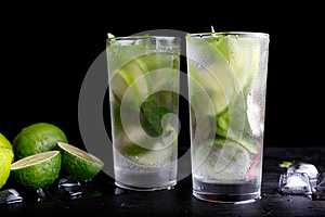 Mojito traditional summer vacation refreshing cocktail alcohol drink in highball glass