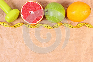 Fresh fruits, centimeter and dumbbells for fitness, concept of healthy lifestyles