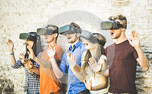 Friends group playing on vr glasses outdoors - Virtual reality