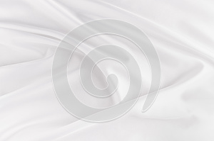 White smooth elegant silk or satin fabric texture with liquid wave.