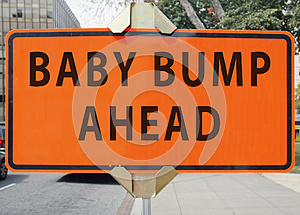BABY BUMP AHEAD road sign.