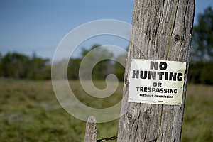No hunting sign on post