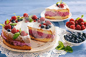 Delicious homemade cake with berry cheese cream.