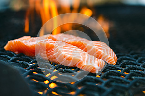 Grilled salmon steaks on a grill. Fire flame grill. Restaurant and garden kitchen. Garden party. Healthy dish.