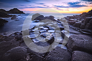 Sunset over rocks formation Giants Causeway, County Antrim, Northern Ireland, UK