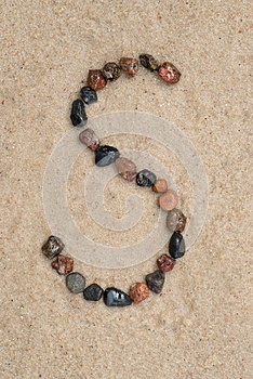 Pebble s letter on sand