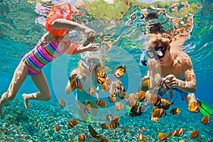 Underwater photo. Happy family snorkelling in tropical sea