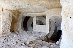 Interior of a cavern in ancient town of Matera. Matera stones Sassi di Matera are one of the first human settlements in Italy.