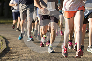 Group of runners racing a 5K on a dirt path