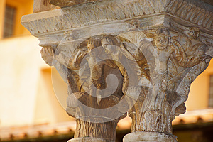 Cloister of the Benedictine monastery in the Cathedral of Monreale in Sicily. General view and details of the columns and capitals