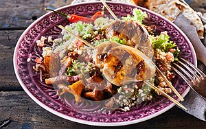 Barbecue chicken skewer dish with quinoa close up