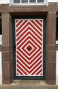 Old Wooden Front Door With Red And White Paint Stock Photography - 100016432