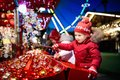 Kids At Christmas Fair. Children Shopping Xmas Gifts. Royalty Free Stock Images - 100059689