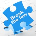 Law Concept: Break The Law On Puzzle Background Royalty Free Stock Image - 100140636