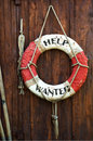 A Worn Life Saver With The Caption Help Wanted Stock Photography - 10036142