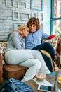 Couple Hugging On A Sofa Royalty Free Stock Images - 100325339