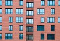 Architectural Exterior Detail Of Residential Apartment Building With Brick Facade Royalty Free Stock Images - 100412869