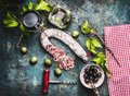 Italian Food Still Life With Glass Of Red Wine, Olives And Sausage On Rustic Background Royalty Free Stock Images - 100562789
