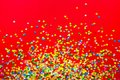 Frame Made Of Colored Confetti. Red Background. Royalty Free Stock Images - 100701149