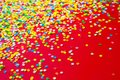 Frame Made Of Colored Confetti. Red Background. Royalty Free Stock Image - 100701326