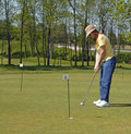 Lady On Golf Putting Green Royalty Free Stock Photo - 10097695