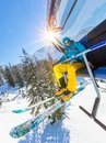 Skier Sitting At Ski Lift In High Mountains During Sunny Day Royalty Free Stock Images - 101620269