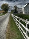 Ohio Amish Country With A Barn And A White Fence Stock Image - 101989391