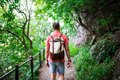 Young Man Walking In The Woods Royalty Free Stock Photo - 102092435