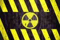 Radioactive Ionizing Radiation Danger Symbol With Yellow And Black Stripes Painted On A Massive Concrete Wall Royalty Free Stock Photos - 102137258