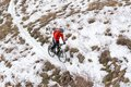 Cyclist In Red Riding Mountain Bike On The Snowy Trail. Extreme Winter Sport And Enduro Biking Concept. Royalty Free Stock Photography - 102352927