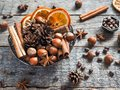 Winter Ingredients Nuts, Cones, Oranges, Cinnamon Star Anise In A Bowl. Rustic Style Royalty Free Stock Photography - 102568507