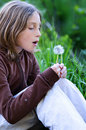 Girl Blowing A Dandelion Stock Image - 10279451
