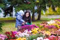 Mother With Little Son Plays In Autumn Park Stock Photo - 102934460