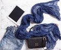 Set Of Woman`s Items Including Scarf, Tablet, Handbag And Jeans. Royalty Free Stock Photo - 103194875