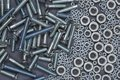 A Bunch Of Screw Nuts And Bolts On A Gray Background Royalty Free Stock Image - 103249936