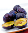 Plums On The White Plate Royalty Free Stock Photography - 10360087