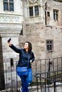 Young Happy Woman Taking A Selfie At  Corvin Castle, Romania Royalty Free Stock Image - 103607396