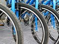 Bicycles For Rent Stand In A Row Royalty Free Stock Photography - 103738767