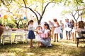 Family Celebration Or A Garden Party Outside In The Backyard. Royalty Free Stock Photography - 103855217