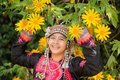 Beautiful Smile Young Hill Tribe Girl In Sunflowers Garden. Stock Photography - 103924222