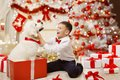 Child Getting Christmas Dog Present, Happy Kid Boy, Xmas Tree Stock Photography - 103989682