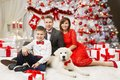 Christmas Family Portrait, Happy Father Mother Child Boy And Dog Royalty Free Stock Image - 103989866