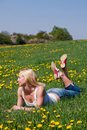 Young Woman Lying On A Meadow Royalty Free Stock Image - 10411566