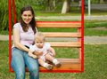 Mother And A Child Swinging In A Playground Royalty Free Stock Photo - 10442435