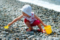 Child Plays With A Bucket And A Shovel Coast Stock Image - 10447981