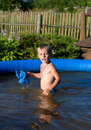 The Child In Inflatable Pool. Stock Photography - 10451922