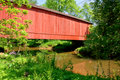 Antique Red Wood Covered Bridge Over A River Creek Royalty Free Stock Images - 10462729
