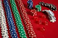 Stack Of Poker Chips On Red Background At Casino Royalty Free Stock Image - 104856156